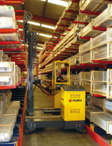 Sideloader in narrow rail guided aisle long load cantilever rack storage