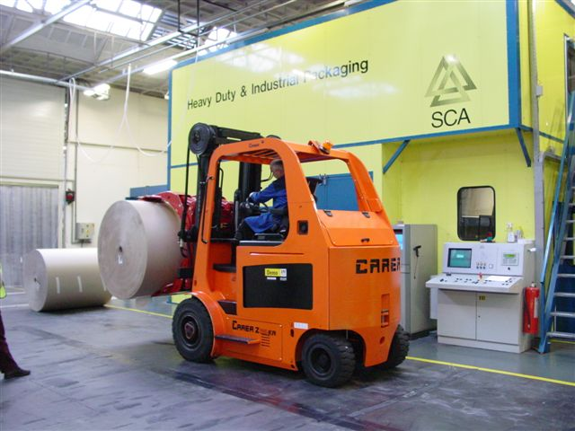 Heavy Duty compact Z series forklift shown with large paper roll clamp